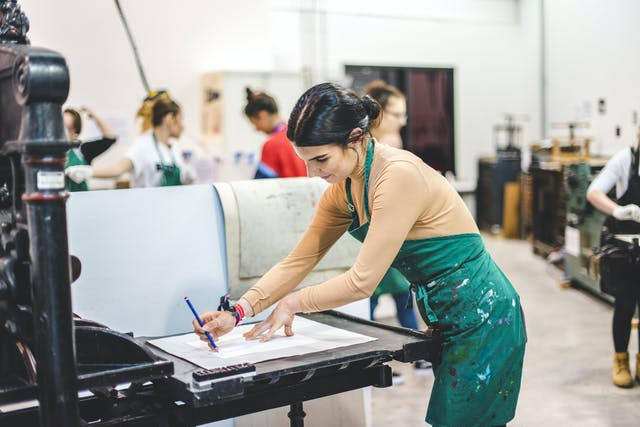 Plymouth College of Art student in printing studio