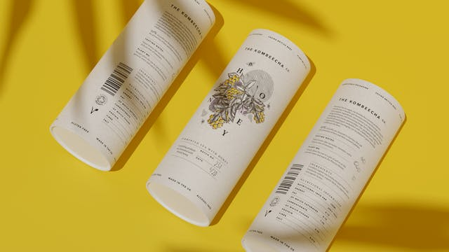 Image shows an overhead shot of the kombucha drinks with illustrative bee branding against a mustard yellow background