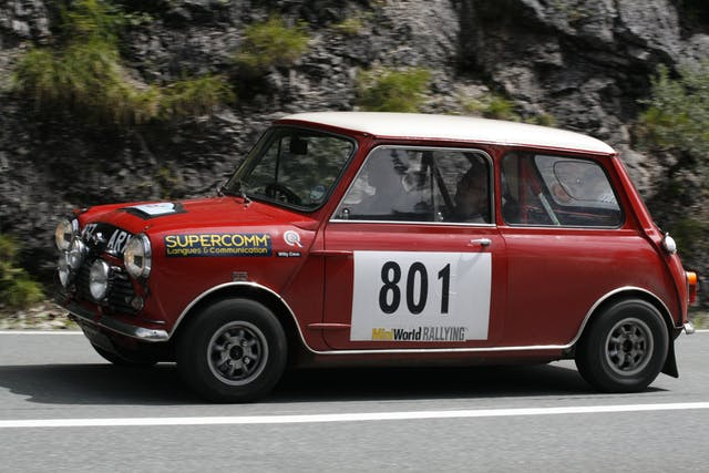Peter Barker and co-driver Willy Cave speed onwards to the finish of the 2007 Rallye des Alpes in their 1962 Mini Cooper