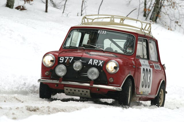 The Mini Cooper of Peter Barker and Willy Cave negotiate the ice and snow of the Rallye Monte Carlo Historique in 2008