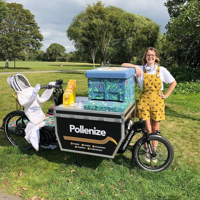 Brittany Clarke Marketing and Communications Assistant at Pollenize with their E cargo bike and decorated beehive in Central park Credit University of Plymouth