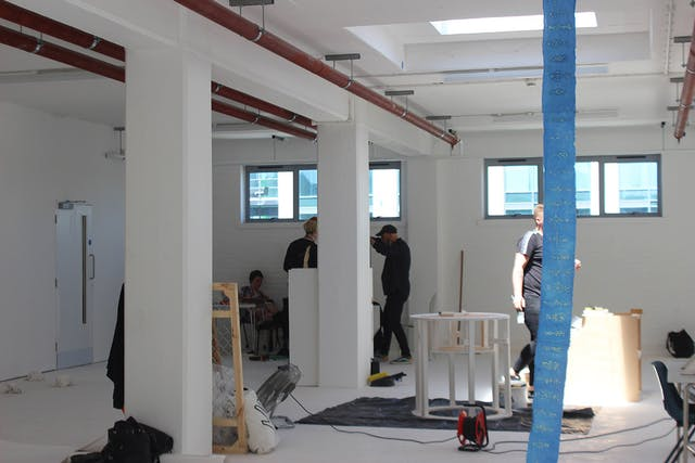Students set up an exhibition in a white room with large pillars Testspace at Karst June 2021 Photos by Eloise Dodsworth