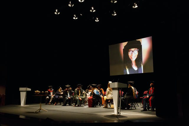 Image shows Honorary Fellow Jo Arscott on a screen as she gives a virtual speech to graduates