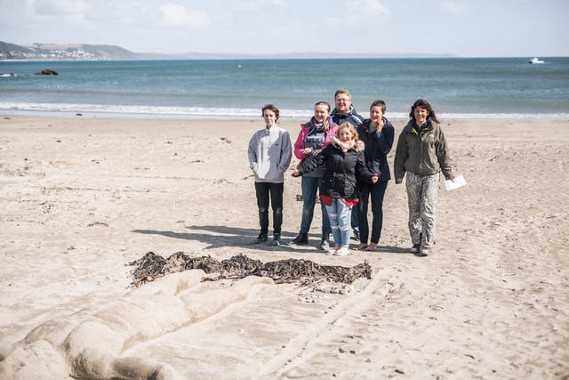 BA Hons Extended Degree students from Plymouth College of Art with their sand sculptures on Looe beach Photo by Taylor Harford