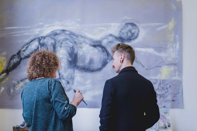Making Change exhibition Nicola Ellis with Employability Officer Jack Viant