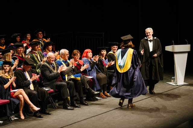 Andrew Brewerton congratulates graduating students