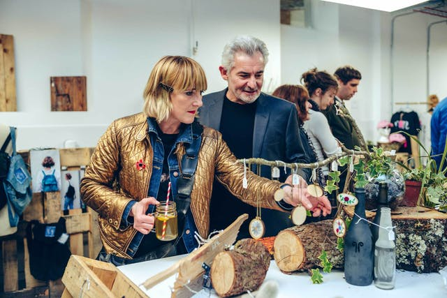 Katie Greenyer of Pentland Brands and Principal Andrew Brewerton explore student work on show at the Palace Court campus opening