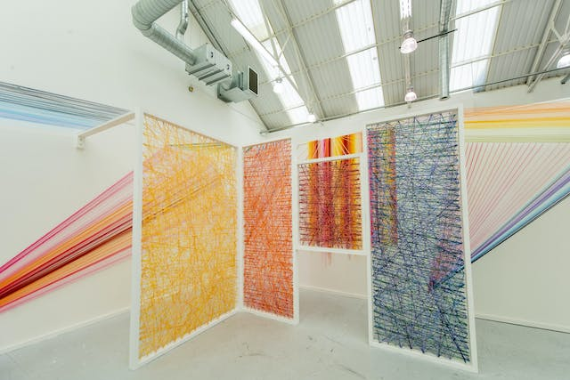Plymouth College of Art Fine Art installation by Megan Caladwaldr using coloured wool stretched over frames and walls